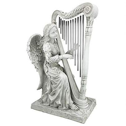 Angel garden statue playing harp